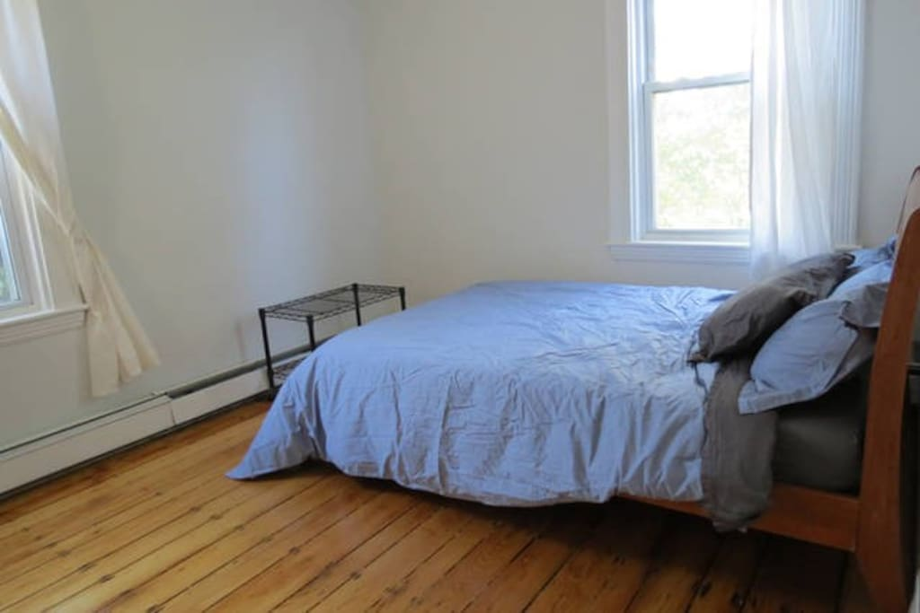 Quiet, sunny bedroom with full size bed. Looks out over yard and park.
