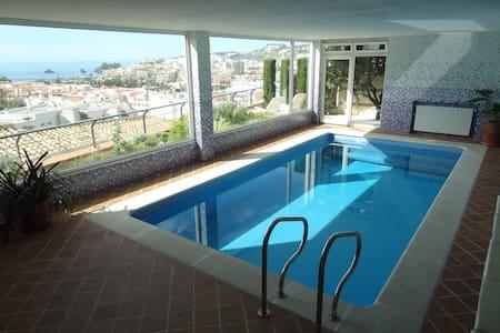 Swimming pool solarium with views
