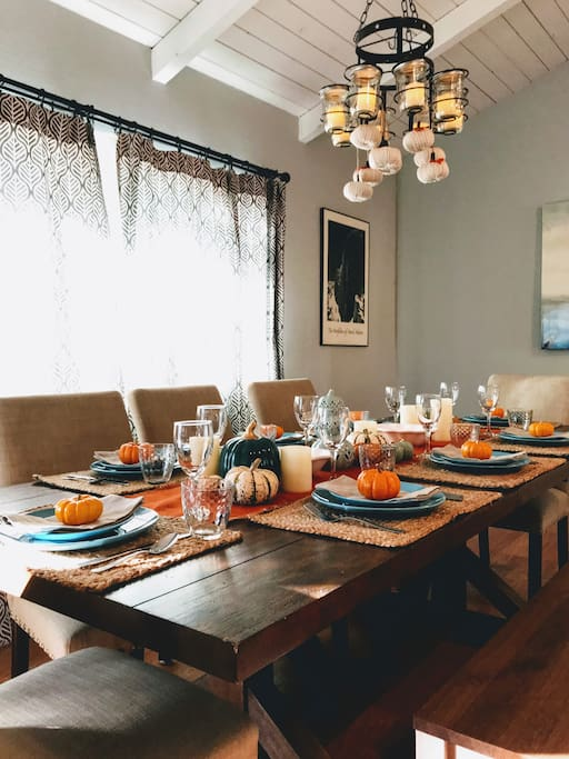 We love hosting family and friends in a space that's both inviting and stylish! Table is shown set for 8 - 4 additional place settings available (house sleeps 9). Serve ware and decor are included.