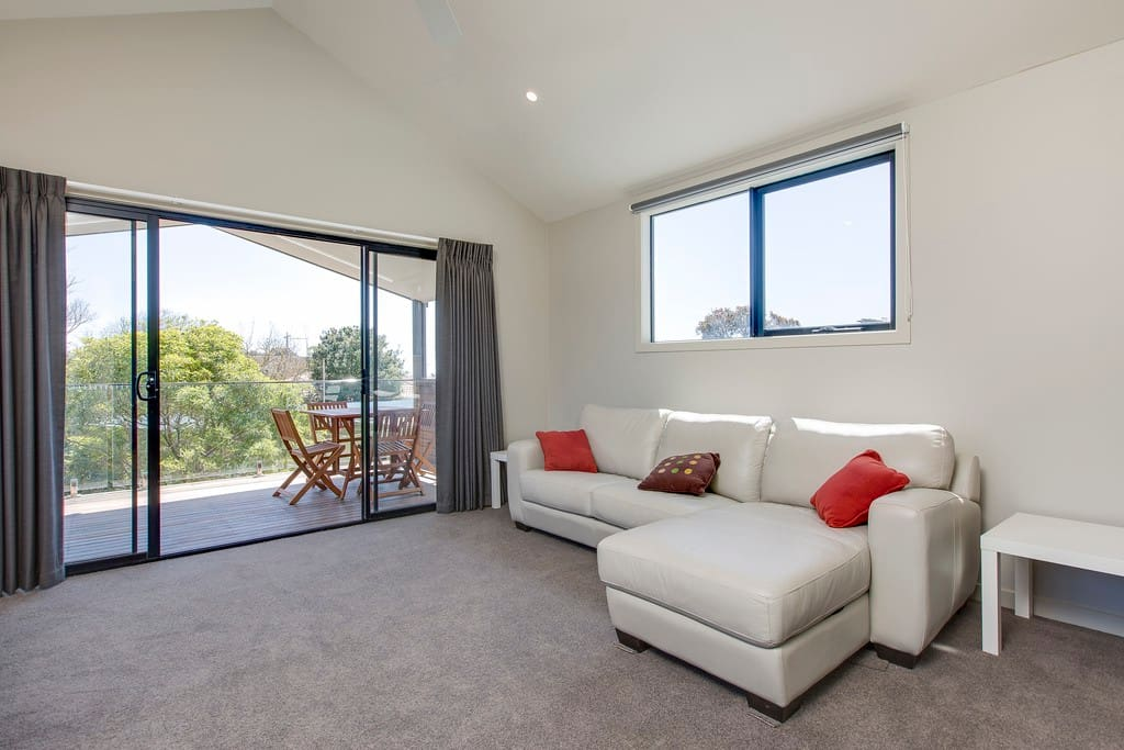 The Lounge Room with comfortable leather chaise, TV/DVD and foxtel.