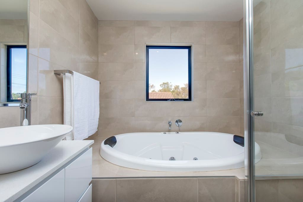 Bathroom with double person spa bath, endless hot water. separate shower.