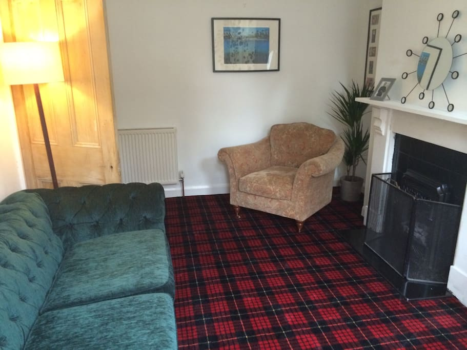Cosy living room has cable TV and gas fire.