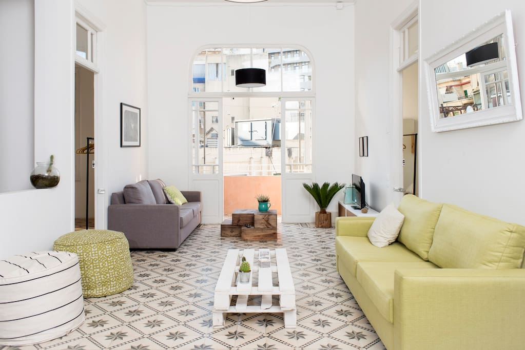 The tiles, high ceilings and tall windows of this apartment are typical of old Lebanese houses.