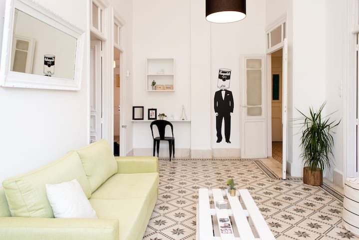 The large living room opens up to four double bedrooms, sleeping up to eight people in total.