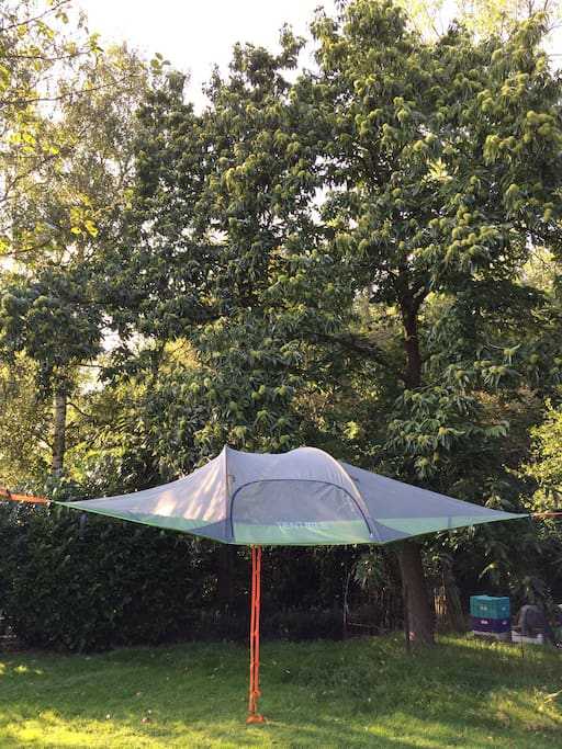You can sleep, rest or play floating among the trees when the tree tent is hanging in the garden in spring and summer!