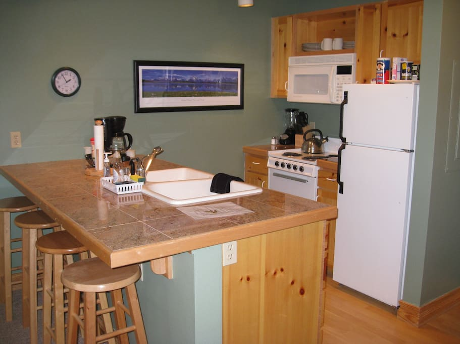 The 1BR kitchen still has all you need for home-cooked meals