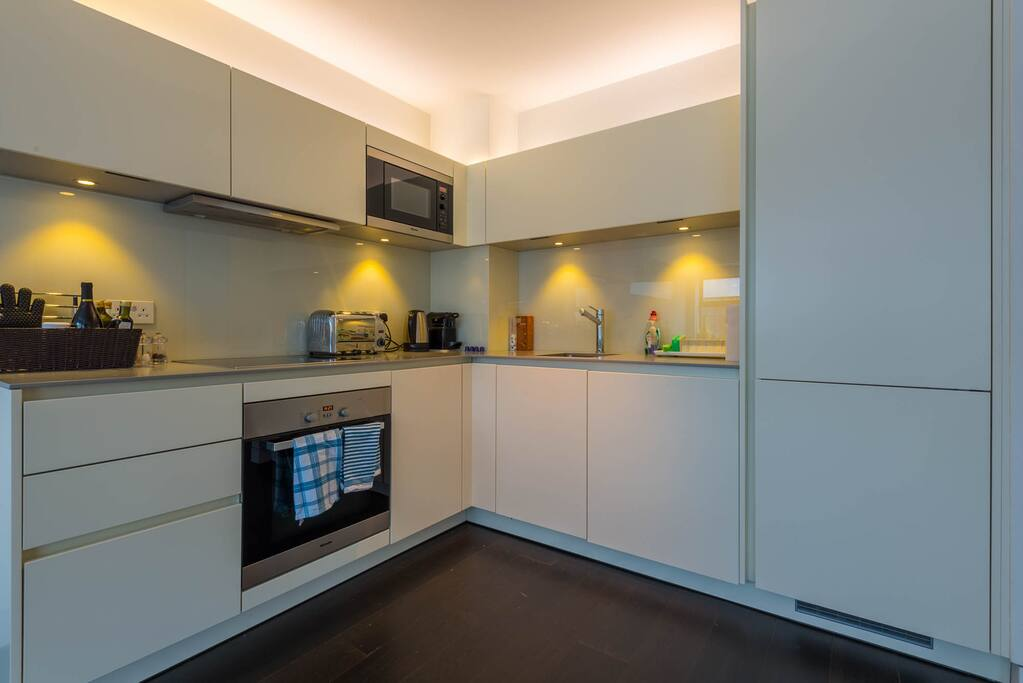 Modern bright kitchen completed in 2013. Nespresso. Miele oven, hob, extractor and microwave. Siemens dishwasher and washer/dryer. Full size European fridge. Plenty of counter space and all essential equipment.