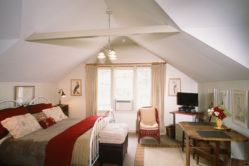 Charming studio interior with luxurious king size bed.