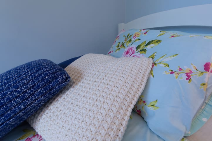 Get comfortable amongst all those pillows - with a book? Or just enjoy the view from the bed in the single room??