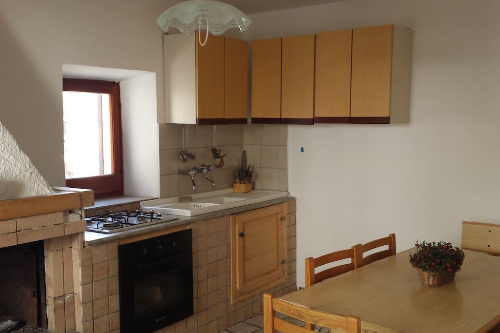 The kitchenn + fireplace