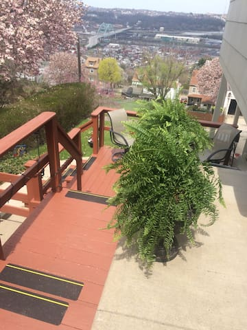 Stairs leading to backyard and hot tub area