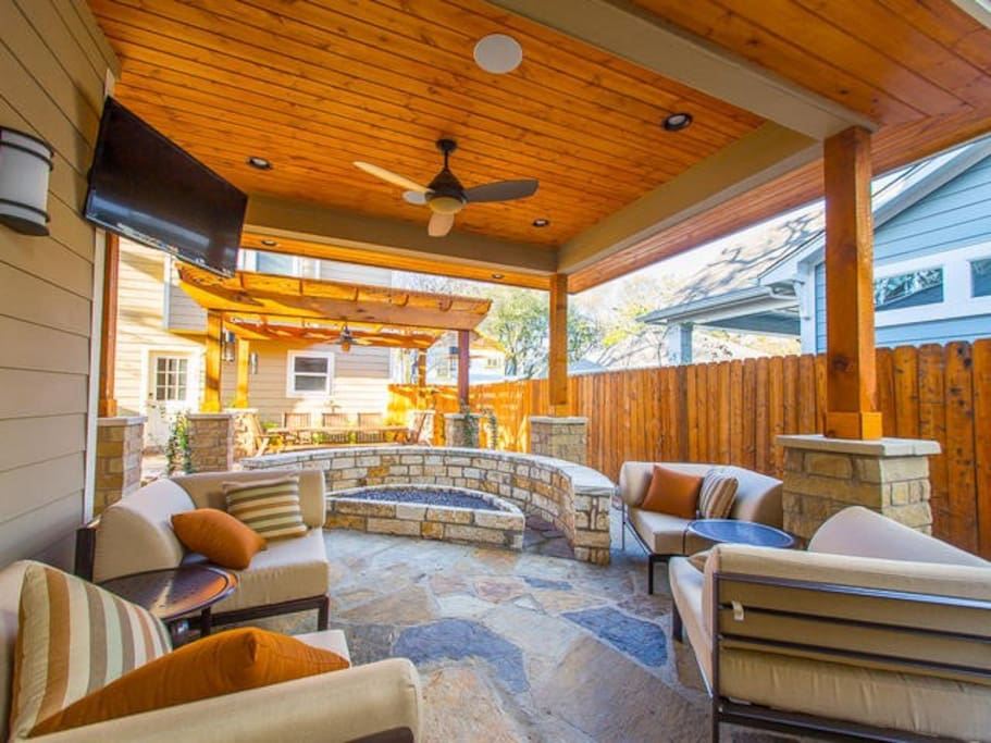 Covered outdoor patio and fire pit complete with TV, ceiling fan and sounds system.