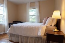 bedroom 2 with queen bed, full closet and ceiling fan