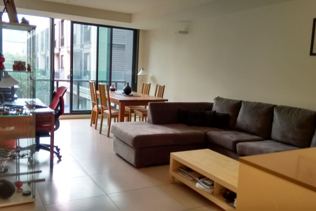 Large open living area with access to two balconies