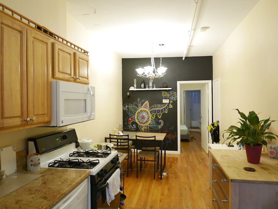 Kitchen with island, and dining room area.