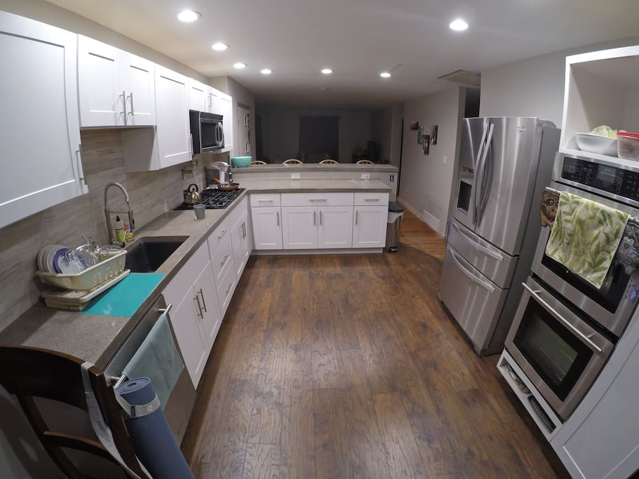 Another fresh renovation, well-lit, and fully stocked with all the fun kitchen things.