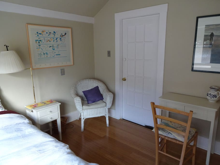 Single bedroom with desk, table and chair