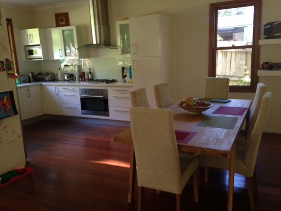 Open plan dining /kitchen and living area with direct access to garden.