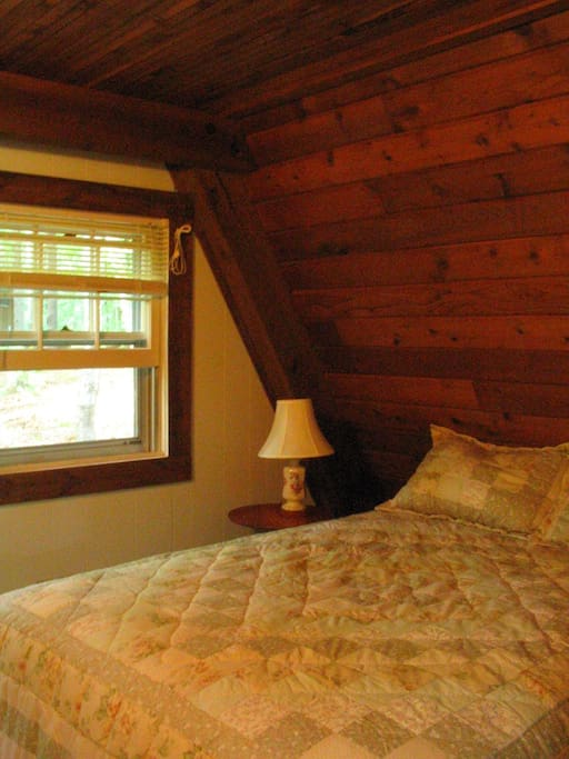 Queen size bed in small downstairs bedroom