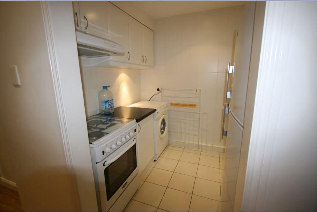 Kitchen and Laundry -washing machine, gas stove, fridge