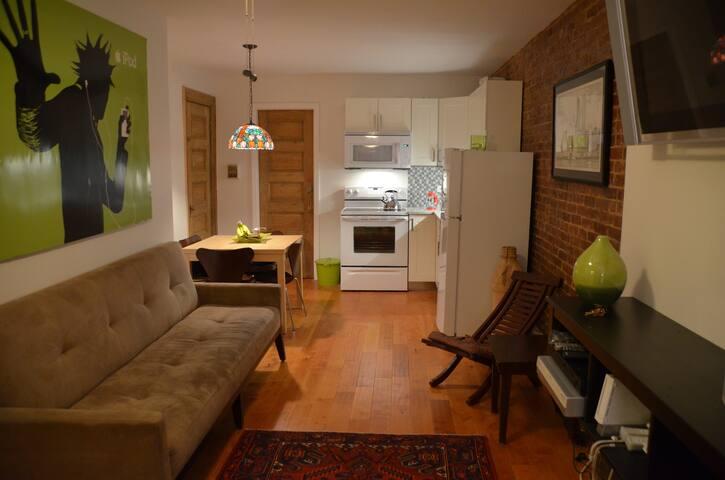Living room looking toward kitchen / bedroom.