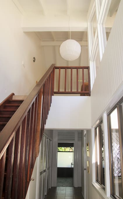 Front entrance door leads to the bedrooms, courtyard, bathroom and laundry behind louvres. The stairway leads to the open plan living and balcony space.