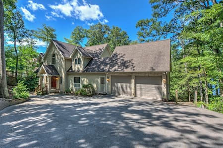 Lakefront, dog-friendly home w/ hot tubs, game room, dock & space for 25!