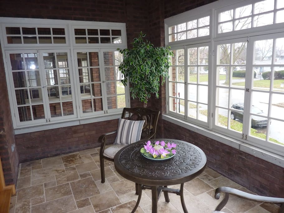 Windowed front porch. Great place to sit in the sun or catch a breeze.