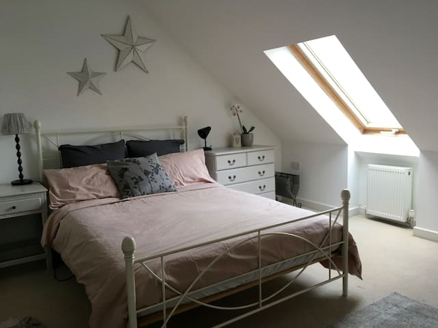 Large sunny attic room with en-suite bathroom