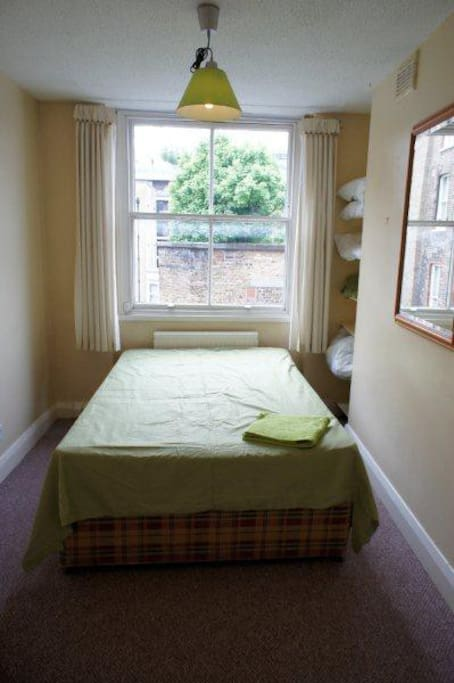 Kiwi room is quiet on the rear of the property comprising of double bed, desk, chair, shelving, walk in wardrobe.