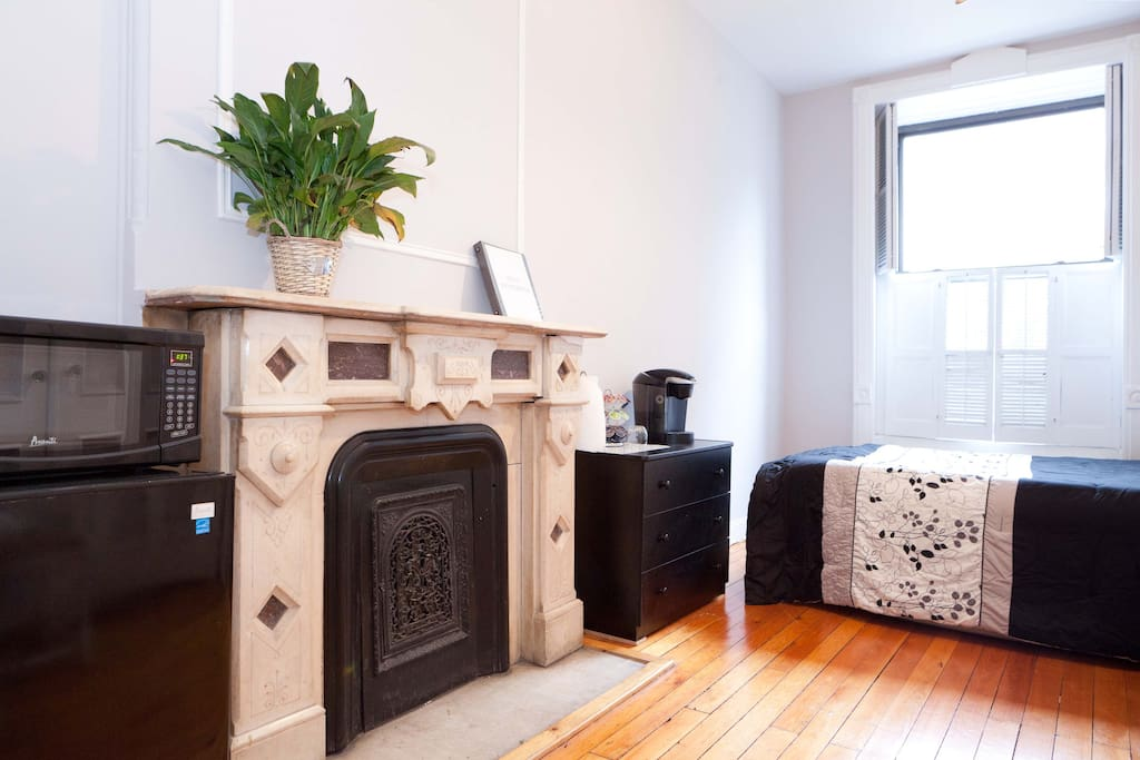 Bright, cozy room with coffee maker and microwave