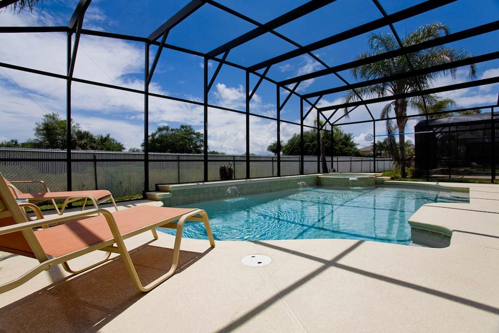 South-facing private pool with spillover spa, luxury patio furniture, barbecue grill & more