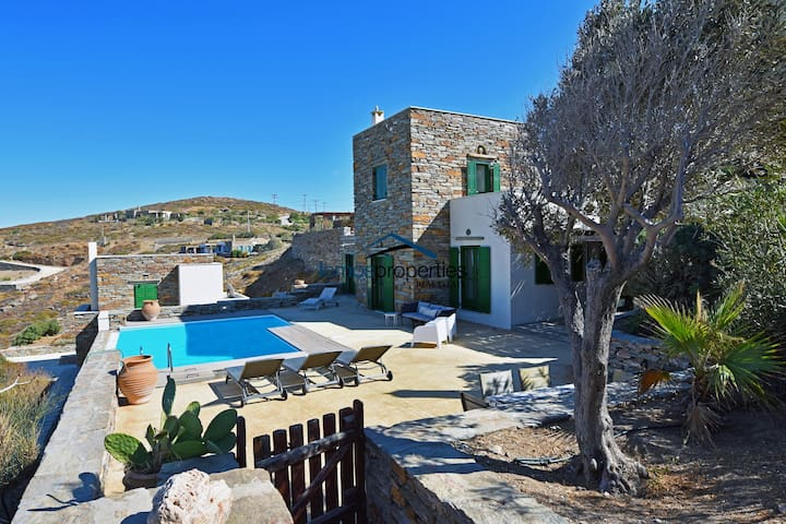 Stone villa with a swimming pool and a sea view