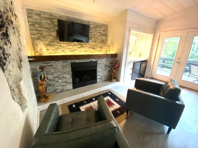Sitting area off Master (second floor) Roku TV custom fireplace mantel propane fireplace