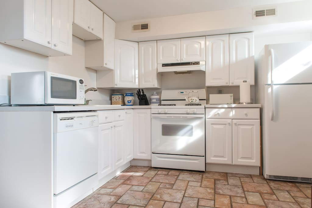 Full kitchen with dishwasher and microwave.