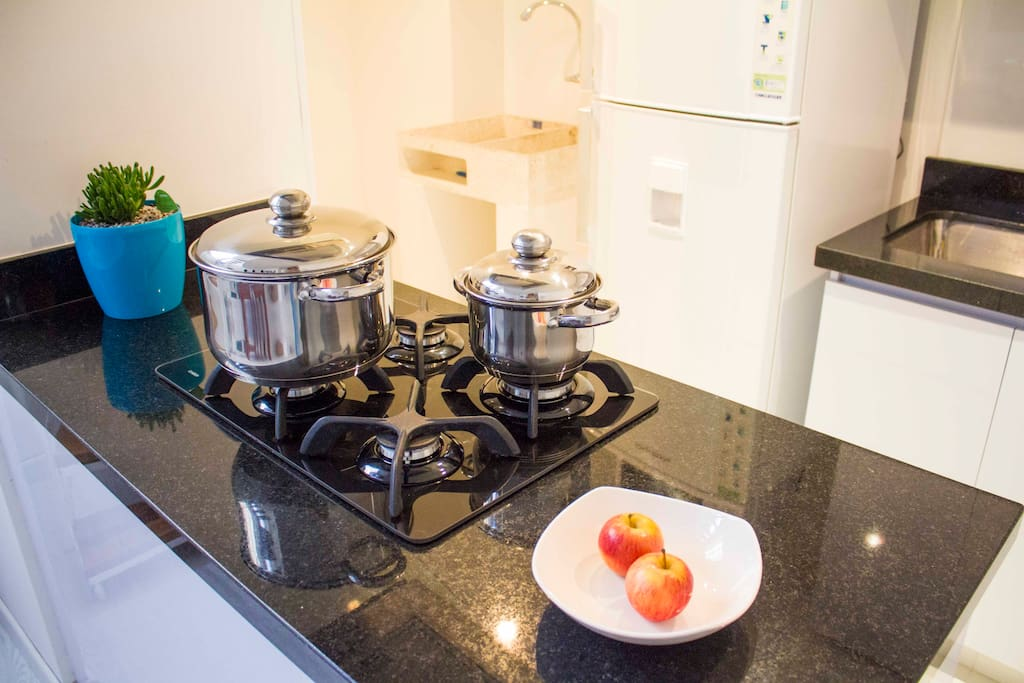 The stove with glass cover invites you to cook delicious meals.