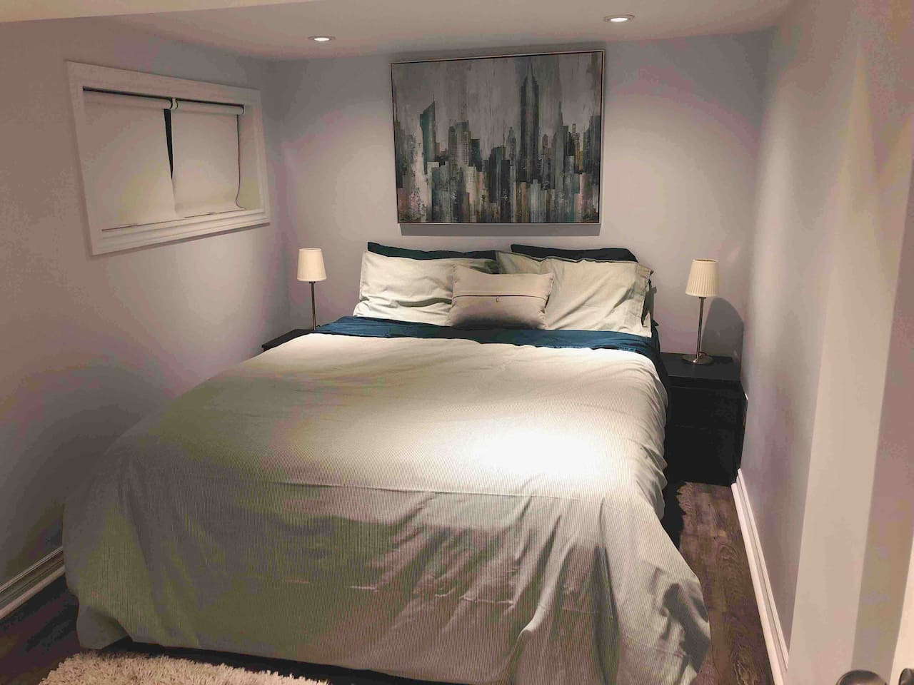 Bedroom with queen size bed and drawers
