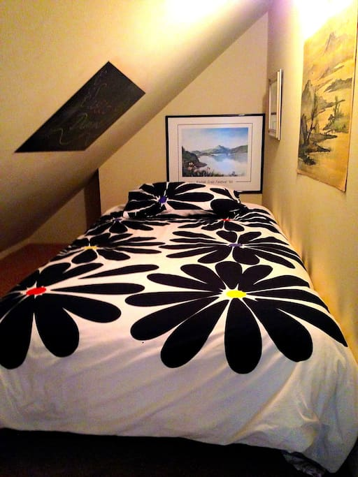 Twin bed in a private nook in the main bedroom