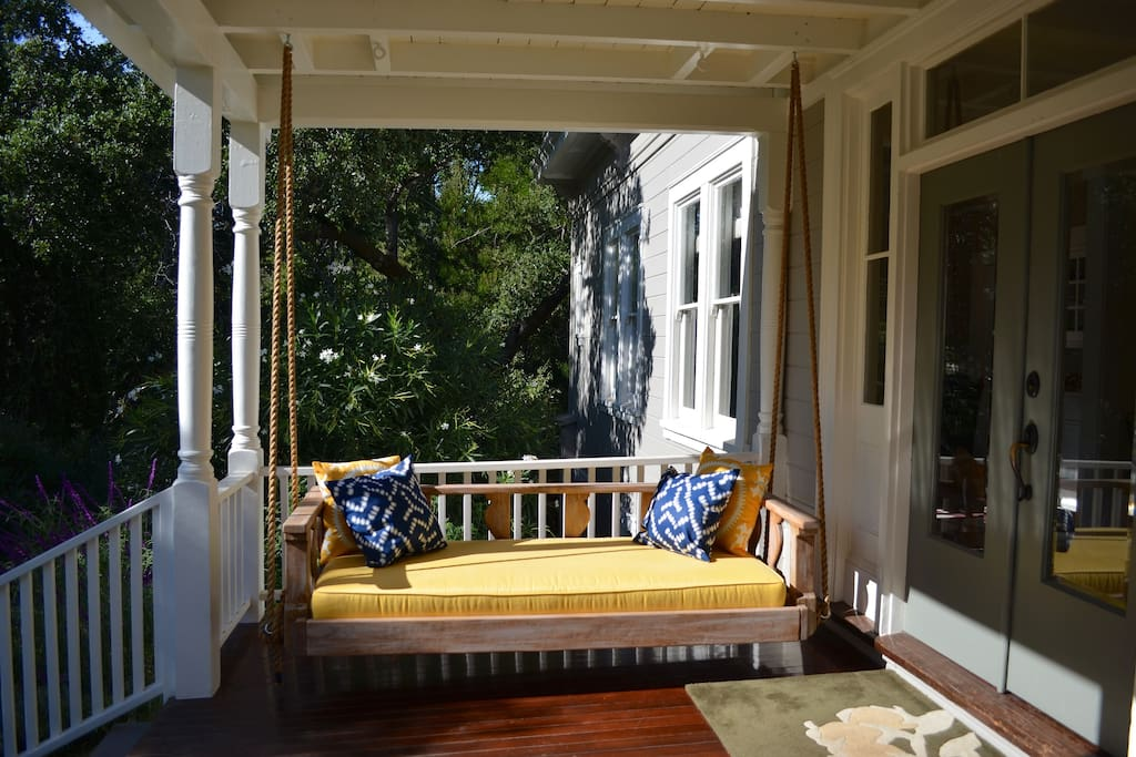 Bed-style porch swing on our lovely front porch, looking over the garden.