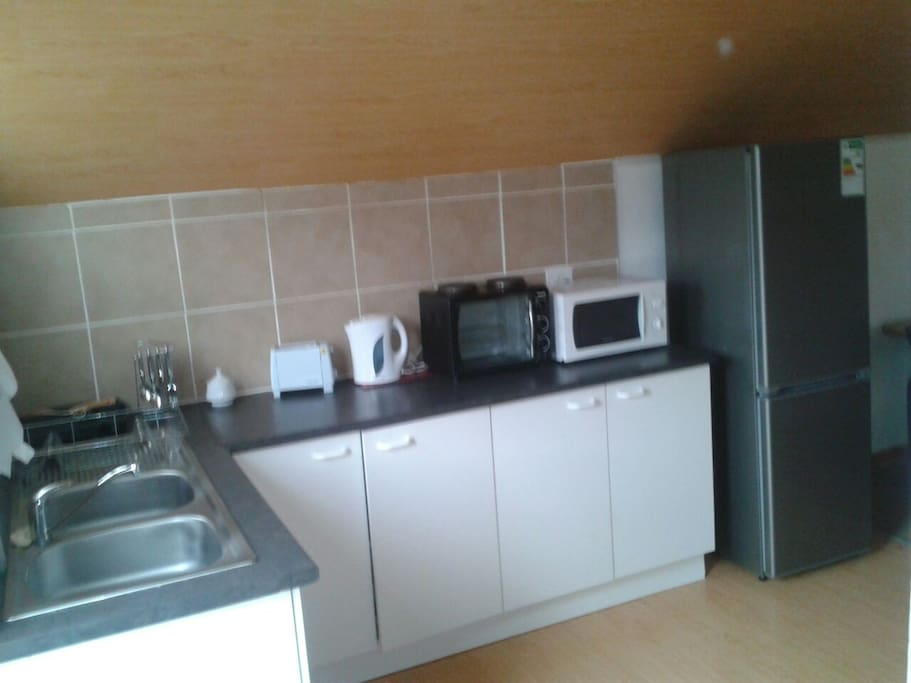 Well equipped kitchen with fridge/freezer, microwave and bench top oven.