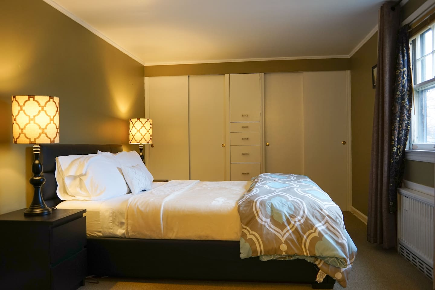 Large, comfortable bedroom with queen bed and numerous closets. There are also a sofa bed, pull down couch bed and blow up queen mattress.