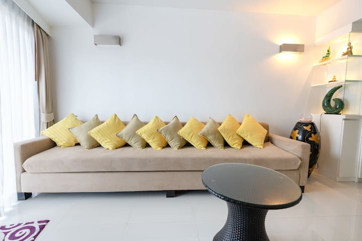 Plenty of cushions on the custom made settee. It's so long - 3metres- even the tallest guests can unwind