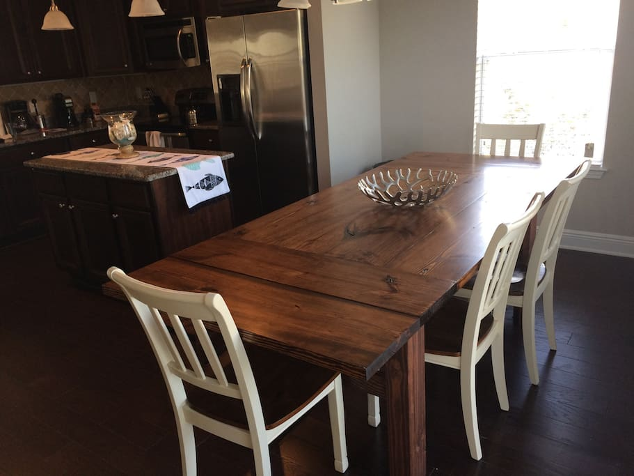 Gorgeous new farm house table where you can entertain 7-8 people comfortably. If you need more  room to feed let us know and we can have the leafs/breadboards available to seat 8+
