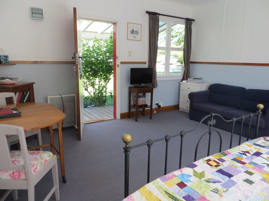 The cottage is studio style with a combined bedroom and living area.  As well as the Queen bed there's a fold out couch for the kids and also a portacot and highchair available (please bring your own bedding for the portacot)