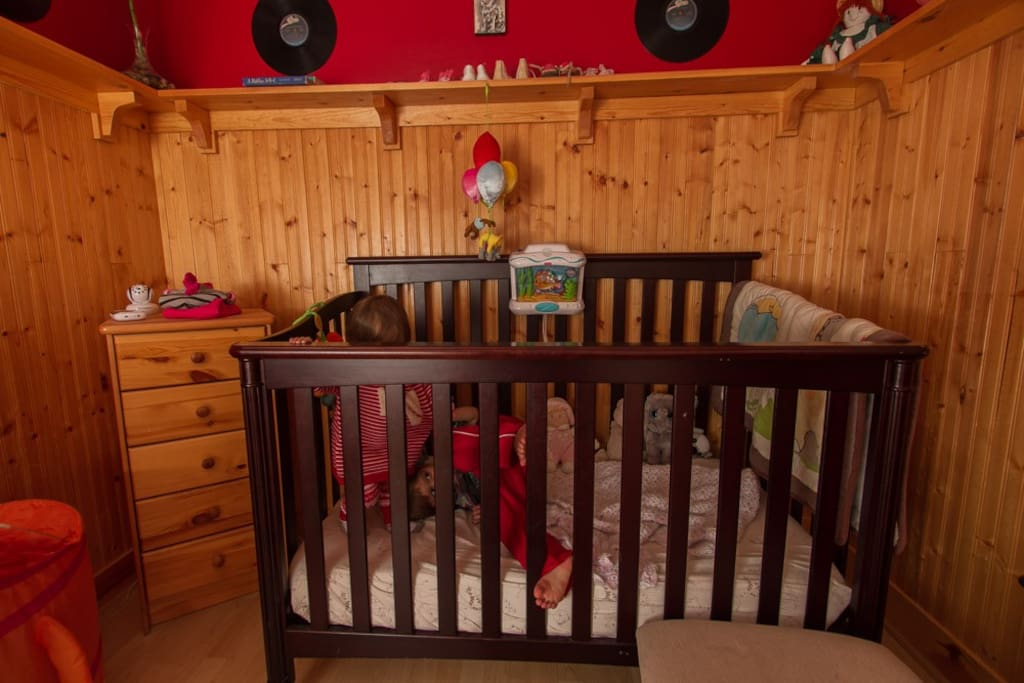 Baby's room with crib and change table.
