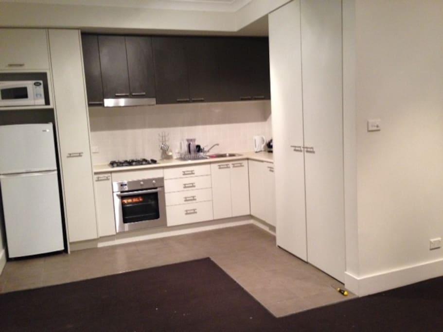 Kitchen with fridge/freezer/new oven