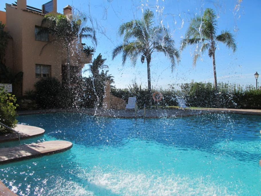 Beautiful pool with water fall and sea views in a tropical garden