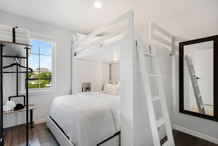 All bedrooms feature this custom-designed bunk bed with queen mattress (lower) and double mattress (upper).