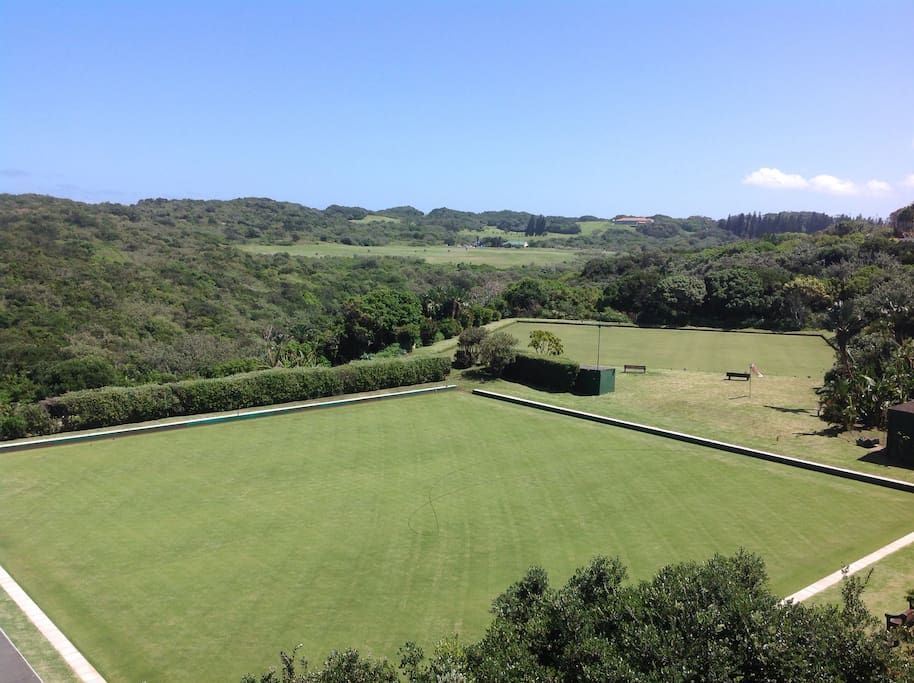 View from the balcony over the bowling club, driving range and golf course at the back.