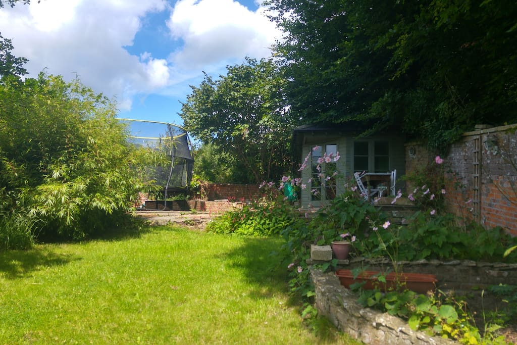 View from studio with garden trampolene and summer house